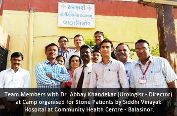 Team Members with Dr. Abhay Khandekar (Urologist - Director) at Camp organised for Stone Patients by Siddhi Vinayak Hospital at Community Health Centre - Balasinor.