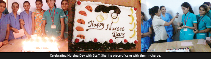 Celebrating Nursing Day with Staff. Sharing piece of cake with their Incharge.