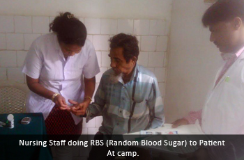 Nursing Staff doing RBS (Random Blood Sugar) to Patient at camp.