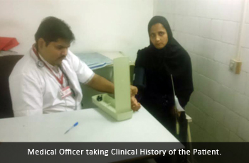 Medical Officer taking Clinical History of the Patient.